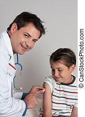 Immunisation or Vaccination - A child receives an...