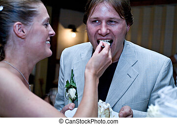 Bride feeding her groom the pie - Bride feeding her husband...