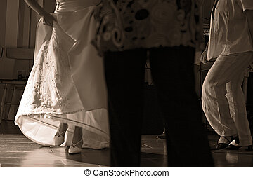 Dancing feet - People on the dancefloor during a wedding...
