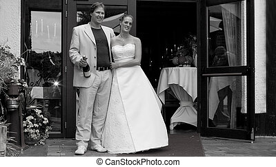 Weddingcouple posing - Bride and groom posing in front of...