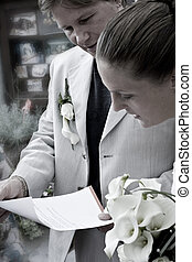 Weddingcouple and letter - Wedding couple reading a letter
