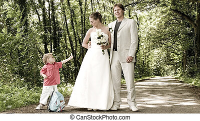 wedding couple and child - Young wedding couples son...