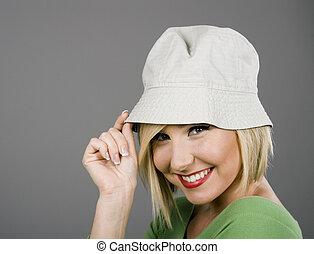 Blonde Tipping Cap and Smiling - A blonde model in a silly...