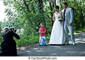 Photographing a wedding couple - pictures being shot of a...