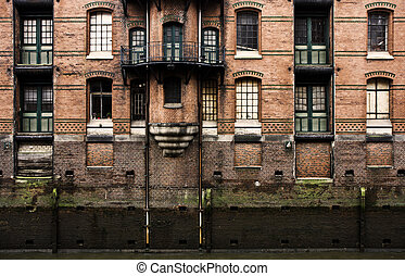 Warehouse facade - Old warehouse facade in the historic...