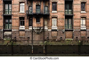 Warehouse facade - Old warehouse facade in the historic...