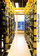 Network servers - A shot of network cables and servers in a...