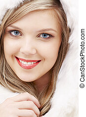 lovely blond in fur - closeup portrait of lovely blond in...