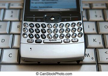 Cell phone on a laptop