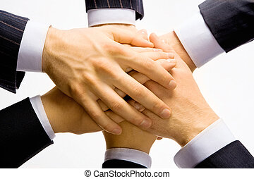 Business team - Pile of hands of people on top of each other...