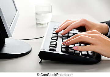 Typing - Photo of female hands on the keyboard of computer...