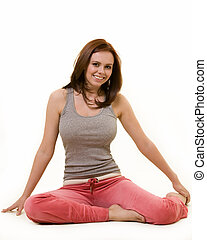 Floor exercises - Attractive auburn hair or brunette woman...