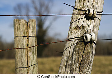 Electric fence - Close up shot of an electric fence in a...