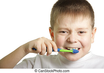 Brushing teeth - Boy brushing teeth isolated over white...