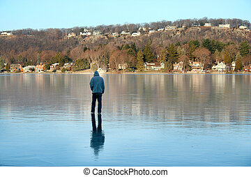On Thin Ice - A man walking on a frozen lake