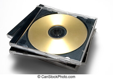 CD/DVD case - Stack of classic CD/DVD case with golden disc