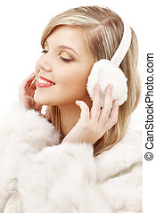 smiling blond in furry headphones - picture of smiling blond...