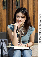 College student - A beautiful young college student studying...
