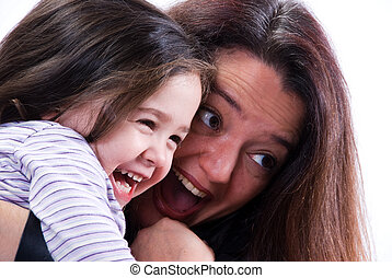 Having Fun - Mom and girl playing on white background