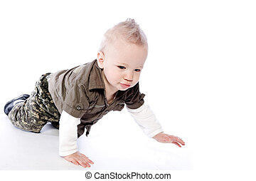 Baby boy crawling - Studio portrait of a crawling baby boy