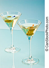 martini - two bocal of martini with olive over blue