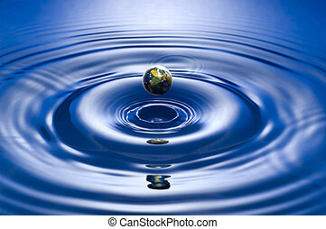 drop - earth drop on blue background close up shoot