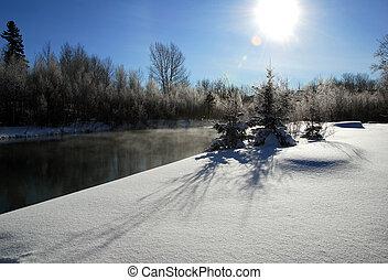 Winter Landscape - A winter landscape showing a foggy river...