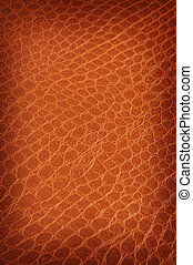 Tanned crackled leather background close up shot at an angle