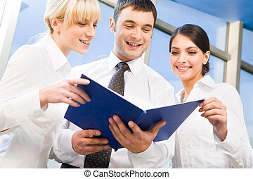Business team - Three business people met together to...