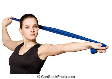 Stretching with a Resistance Band - Young girl is sporting...