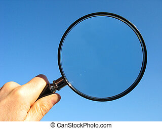 Magnifying Glass with blue sky background