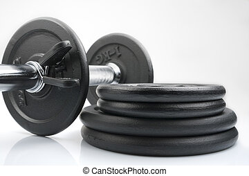 Weights - Stack of black weights on a white background....