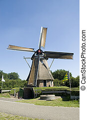 Dutch windmill - Dutch wind-mill in Holland used for corn