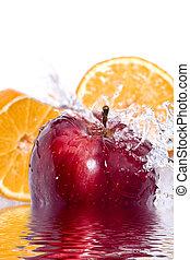 Apple and orange splash - Water splashing down on an apple...
