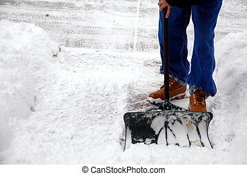 Too much snow - Man cleaning snow from a walkway with copy...