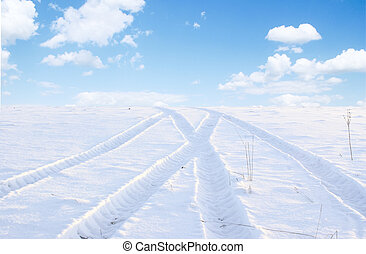 White way. - A winter landscape, Snow desert, traces of the...