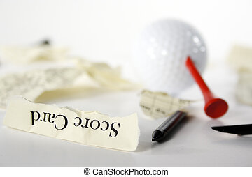 Golf score card teared apart, with peg through ball, due to...