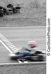 winning kart - speeding kart passing finish line