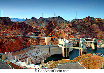 Hoover Dam - Rising more than 700 feet above the raging...