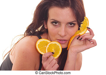 Slices of oranges - Young girl posing and holding slices of...