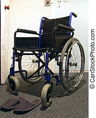 wheelchair - Single wheelchair with the sneakers in the...