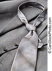 tie - A modern tie and a gray costume