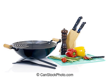 Preparing wok with fresh vegetables on cuttingboard, white...