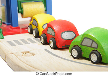 Car washing - Cue of toy wooden coloured cars to washing...