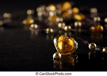 Amber heart on necklace with golden pearls
