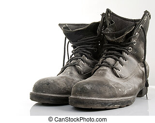 CONSTRUCTION BOOTS - worn in construction boots isolated on...