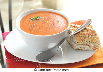 Tomato Soup - Hot tomato soup served with crusty bread.