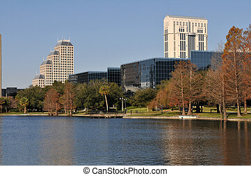Lake Eola - Office buildings reflected in Lake Eola,...