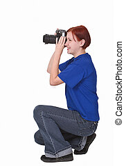 Teen girl photographer - Redheaded girl taking photos with a...