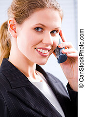 Speaking on the phone - Close-up of a young attractive...
